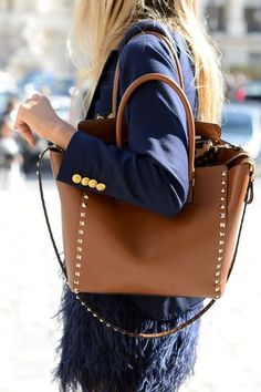 Navy and camel with gold hardware. Feminine chic.