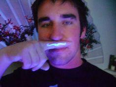Glow in the dark tattoo of a mustache.