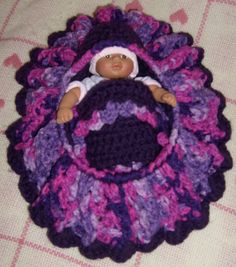 Free Crochet Cradle Purse Pattern. Doll from Walmart (only place I could find a doll small enough, otherwise I never shop there). Great gift for little girl. Very easy pattern to follow. Great for using up your scrap yarn.
