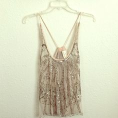 UO Pins and Needles tank top Sequin and beaded mesh tank top. No holes or stains. Small string of beads missing on bottom hem, but very unnoticeable. Urban Outfitters Tops Tank Tops