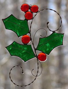 This lovely little sprig of holly is crafted from a beautiful Christmas green glass and five holly berry globs. The sprig measures about 6 x 4 and is detailed with hand formed wire. The solder lines have a shiny silver finish. Clear fish line is included for display. Each of my