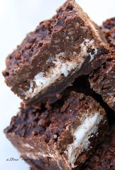 These are great! The top is like a Crunch Bar with rice crispies the middle is marshmallow, and the bottom is brownie mix. I bring them to the party and always leave with an empty pan! Marshmallow Creme Crunch Brownies