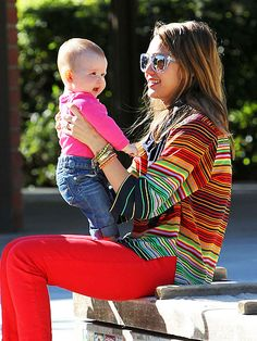She has consistantly been rocking the colored jeans. #jealous!
