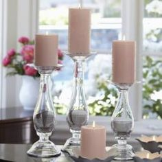 New favorite Pillar Holders for Spring by PartyLite! I filled them up with pastel jellybeans for Easter. Love it!