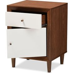 Highlight the handsomely modern feel of your space with the Haven nightstand. Made from sustainably sourced engineered wood and sturdy rubber wood legs with lasting quality, the nightstand is finished in white and walnut veneer, offering a contemporary aesthetic into your living space. The drawer and the door open to reveal internal space that's ideal for storage. Splayed legs complement the white-and-walnut contrast tones for a design steeped in retro, Scandinavian style. Requires assembly…