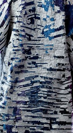 Sustainable textiles design using woven paper & dyed cotton waste to create textured fabrics with striated patterns // Miguel Mesa
