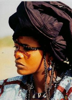 Tuareg woman, Niger. Tuareg women have a great freedom and participate in family and tribal decisions. Descent and inheritance are both through the maternal line, although modern ways continue to encroach on time-honored customs.