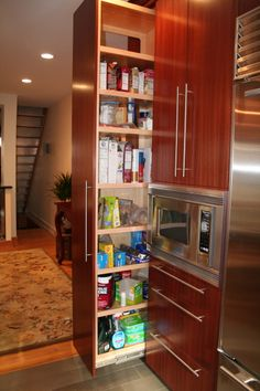 I'm liking these pull-out pantries, tho with a less modern door style :)