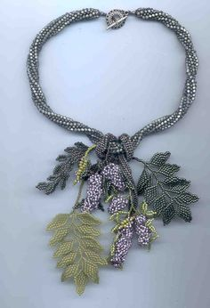 """WISTERIA    Inspired by the wisteria vine, this necklace features the blossoms, leaves and vines using size 11`, 8` and 15` seed beads. Peyote and Herringbone are the main stitches employed along with several """"Invented"""" stitches. This is a one day workshop for intermediate to advanced students."""