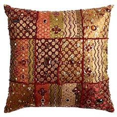 I need/want new pillows for the couch in the family room. I like the idea of a patchwork of shiny, embroidered fabrics with trim in between. I could do that.