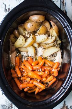 Slow Cooker Garlic Butter Chicken and Veggies -- chicken breast, potatoes, carrots and garlic butter, 6 hrs low in the crockpot