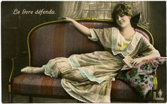 Click on Image to Enlarge This is a lovely Old Photo Postcard showing a French Woman lounging on a Settee! She has on a very pretty Dress and a big Bow in her Hair.