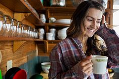 Stock Photo - Smiling young woman drinking coffee in kitchen Coffee Drinks, Drinking Coffee, Young Women, Smile, Stock Photos, Kitchen, Woman, Cooking, Senior Girls