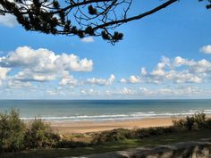 Below the sandy bluffs of Omaha Beach, gentle grassy slopes invite you to laze and take in the view of the English Channel. This peaceful scene gives no hint of the scene that took place here on June English Channel, Normandy France, Ecommerce Hosting, World War Ii, Ww2, Invite, June, Paris, Beach