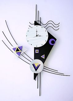 metal wall clock design with art purple colored accents