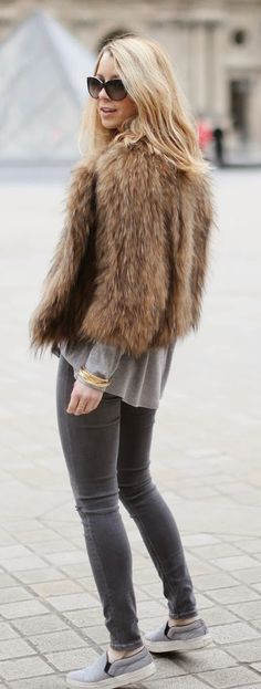 Caroline Louis is wearing a vintage fur jacket