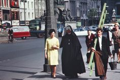 Nun of that: A woman in religious habit walks along O'Connell Street in Dublin with a woman wearing a yellow dress, while a man carries a ladder and another woman holds an umbrella while a man cycles by, in a scene captured in June 1963 Dublin Street, Dublin City, Old Pictures, Old Photos, Irish Free State, Irish Eyes, Colour Images, 1960s, The Past