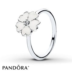 This pretty sterling silver ring from the PANDORA Spring 2015 collection features a primrose with white enamel petals and a sparkling cubic zirconia center. Additional sizes may be available through special order at your nearest Jared location. Style # 190931EN12-54.