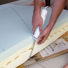 """V berth mattress - We read in sailboat forums about the Spa Sensations memory foam mattress from Wal-Mart. We got the 8"""" Spa Sensatins Memory Foam Mattress for $260 (now $199). We measured the dimensions of the v-berth, then drew it on the mattress. He cut the mattress with an electric bread knife which was easy and didn't tear it."""