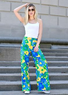 Get this look: http://lb.nu/look/8735183  More looks by Dani Mikaela McGowan: http://lb.nu/mermaidwaves  Items in this look:  J. Crew Wide Leg Floral Pants, Gap White Tank Top, White Converse, Retro Sunglasses   #artistic #classic #retro #styleblogger #ootd #fashionblogger #outfit #look #lotd