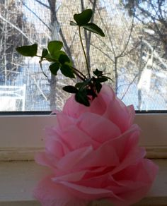 handmade valentine's day gift-bud vase made by gluing $ store rose petals to an empty nail polish bottle