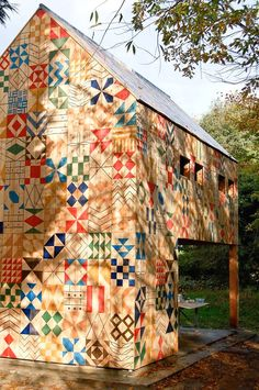 Quilt barn still in progress...there are blocks still left to be painted in.  Isn't this awesome??