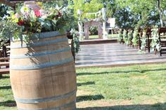 The wine barrel arrangements I'm currently building will be more along this size (but in your colors and flowers).