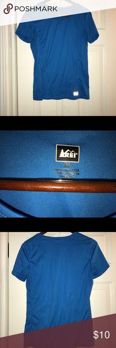 REI Size M Blue workout shirt Blue REI workout shirt in great condition. REI Tops Tees - Short Sleeve