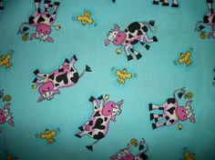 This pattern includes a display of funny cows and yellow birds over a lightweight blue background.   * Cotton 100% * Width 44/45 inches * Primary color is blue
