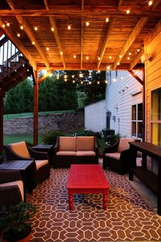 Idea for under deck outdoor patio at new house (2 outdoor rugs put together to make big rug and Christmas lights)--gorgeous feeling:
