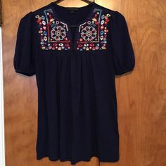 Navy Embroidered Forever 21 Top Super cute short sleeved forever 21 top. Perfect for spring! Navy blue with multicolored embroidered flower pattern. Tight on the sleeves. Slight v neck. Worn a bunch of times but in very good shape. Size small. Happy shopping! Forever 21 Tops Tees - Short Sleeve