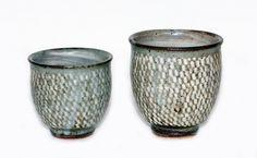 Tatsuzo Shimaoka Set of two stoneware yunomi, rope and slip inlaid decoration, with signed wood box. H. 100mm max