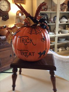A plastic pumpkin painted with Barcelona Orange Chalk Paint® by Annie Sloan.