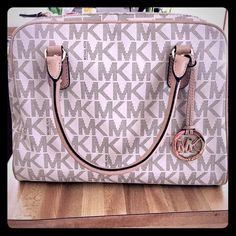 MK Purse Barely Used. Like New. It is a bigger size.  Does have strap to carry as a cross-over bag. Michael Kors Bags