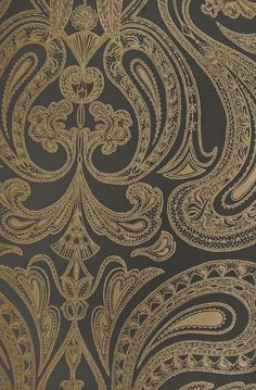 Malabar Wallpaper Dark Cocoa wallpaper with large metallic copper Paisley design in white.
