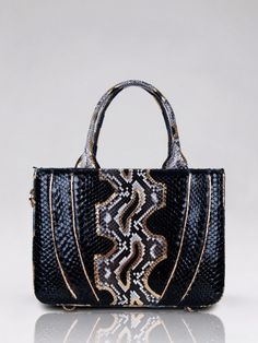 Toluca (Python) from Cashhimi $1400 100 % Python Tote Bag / Top Handle Bag with zip-top closure Body decorated by python strips in matching color.  Protective python wrapped 4 feet. Main compartment contains 1 zip, 1 phone holder ,1 small pockets. Interior suede or leather Entirely hand crafted