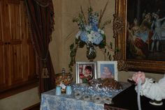 Display Mom and Dad to be baby picture on table with food and cake