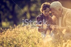 Playful grandfather Royalty Free Stock Photo Get thrilling discounts on images, illustrations, Videos and music clips at iStockphoto with Coupon.