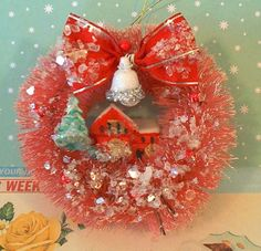 bottle brush vintage wreath with teeny house in the middle