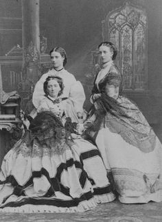 Queen Louise of Denmark with her two eldest daughters, Princess Dagmar (later Empress of Russia) and Princess Alexandra (later Queen of the United Kingdom) in October 1863.A♥W