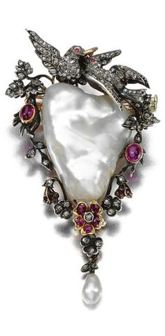 PEARL, RUBY AND DIAMOND BROOCH/PENDANT, LATE 19TH CENTURY. Centring on a baroque pearl, framed by a floral and foliate garland surmounted by a pair of doves, set with cabochon and circular-cut rubies and rose-cut diamonds, suspending a pearl drop, detachable brooch fitting, hinged bail. #antique #Victorian #brooch #pendant
