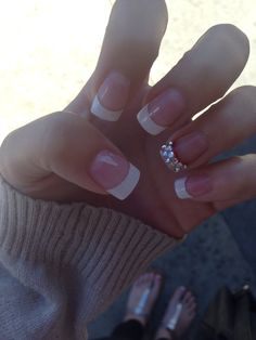 French manicure with diamonds on ring finger nail and accent of red