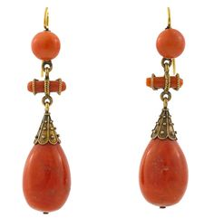 A pair of antique coral pendant earrings, circa 1890 mounted in eighteen karat gold