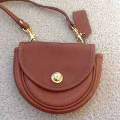 Vintage Coach Crossbody mini bag. Light brown leather in great condition. Brass snap with a removable strap. Has signature Coach leatherware.  Outside has two loops so it can be worn on a belt. Coach Bags Mini Bags