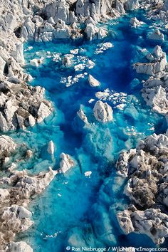 Aerial view of blue meltwater pools on Columbia Glacier, Prince William Sound,  Chugach National Forest, Alaska