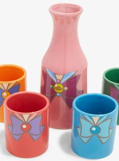 Impress your friends as you enjoy a refreshing beverage using this Sailor Moon sake set! This ceramic drink set features a Sailor Moon carafe with matching Sailor Mars, Sailor Mercury, Sailor Venus and Sailor Jupiter cups. Sailor Mars, Sailor Jupiter, Sailor Venus, Sailor Moon Birthday, Sailor Moon Wedding, Sailor Moon Brooch, Sailor Moon Shirt, Sailor Moon Merchandise, Anime Merchandise