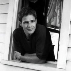 A grinning, young Marlon Brando, in chill mode. lmr