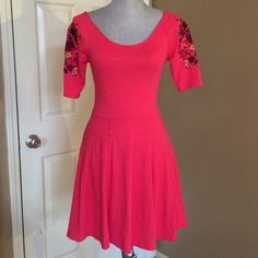 Free People Embroidered Bodycon Dress Muted red stretchy Bodycon dress. You will think it is brand new!  Very clean. A gift to my daughter and she never wore it ... just not her style. Free People Dresses Midi