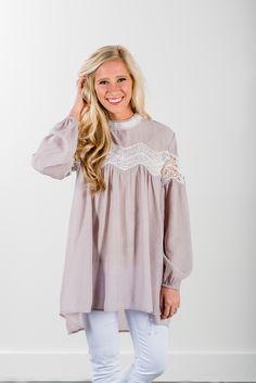 RubyClaire Boutique - Mock Neck Lace Tunic Dress, $34.00 (https://www.rubyclaireboutique.com/mock-neck-lace-tunic-dress/)