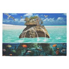 $19.15 Turtle Island Fantasy Secluded Resort Hand Towel  Ocean floor cutaway of turtle with encampment (secluded resort) on the top including wooded hut, rocks, multiple types of trees even a driftwood & carved rock stairway leading up to the wooden hut, with a goddess like women, in a long red scarf, which is blowing in the wind, holding her arms & above her head, standing at the top. The turtle is emerging from the water & there is water rushing off of the shell, around the rocks and…